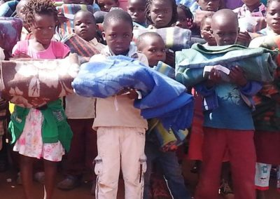 Distributing blankets to vulnerable children